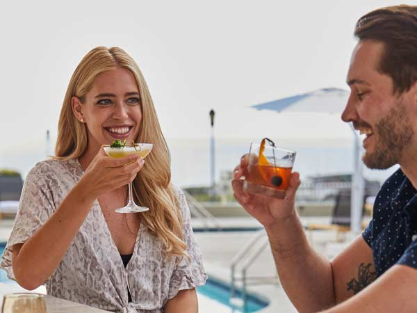 Couple Having Drinks By The Pool.